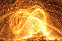 swirling yellow, sparks, fire,  inferno