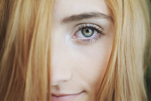 Blonde haired girl with green eyes.