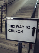 A sign saying 'This way to church'