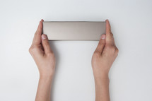 holding a silver box
