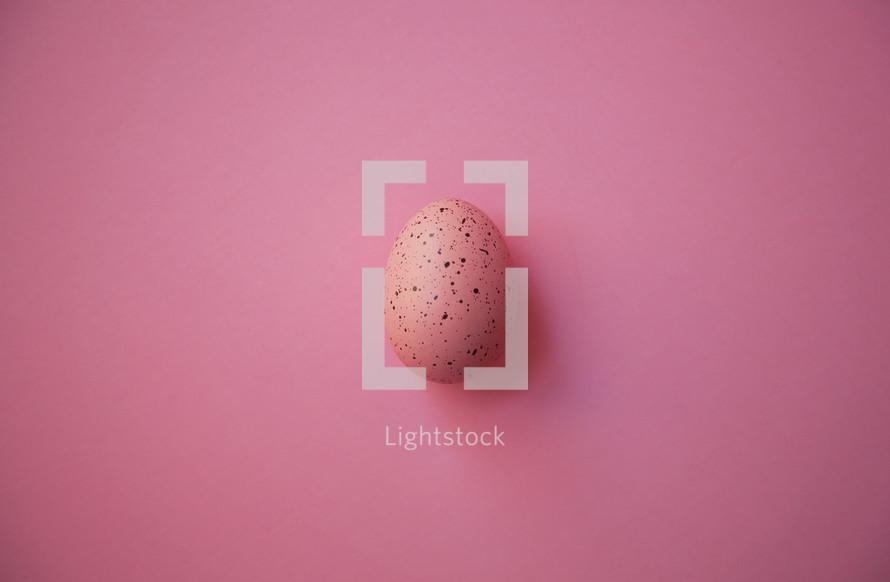 pink speckled Easter egg on pink background