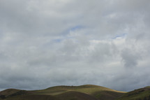 Rolling hills on a cloudy day.
