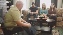 prayer and discussing scripture at a Bible study
