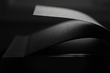 a large book of blank pages in stark light