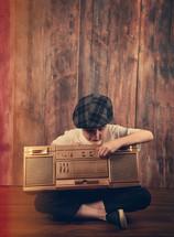 a boy holding a boombox