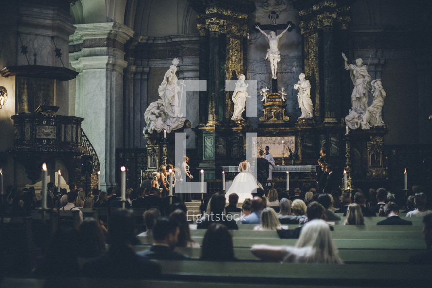 bride and groom exchanging  vows in a cathedral