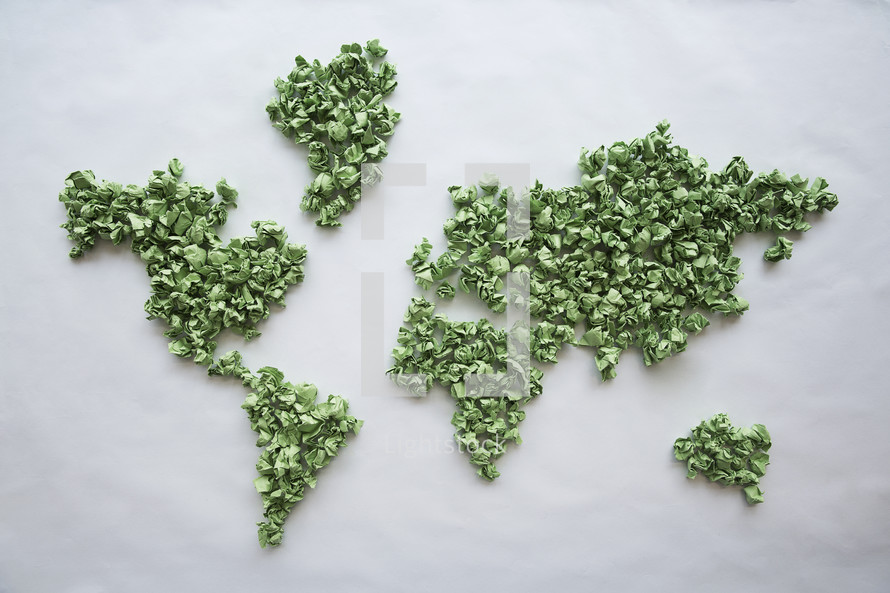 world map made with crumpled green pieces of paper.