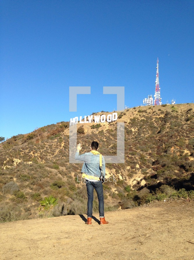 tourist in front of the Hollywood sign