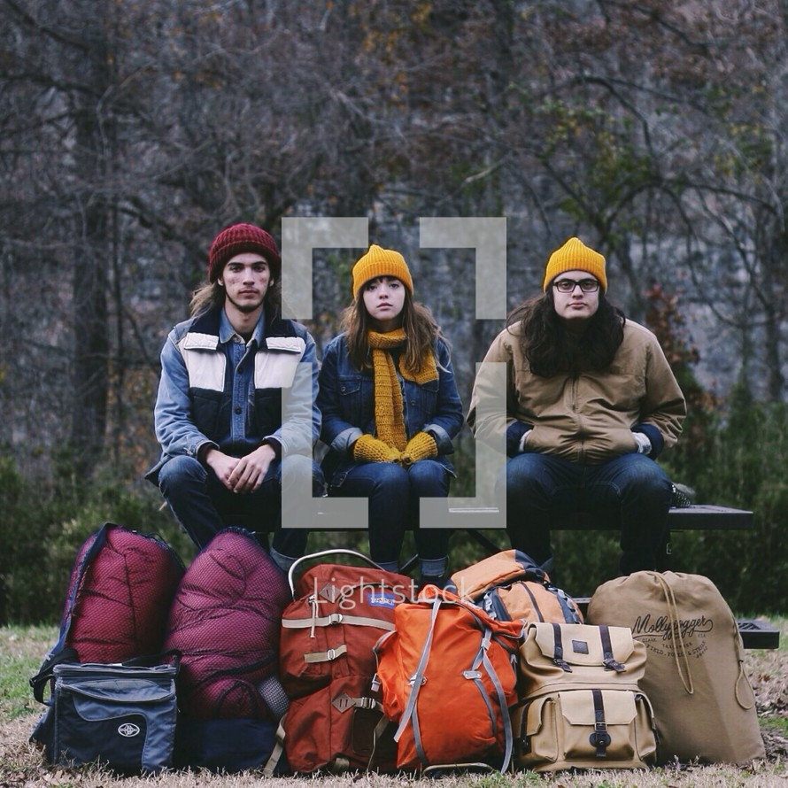friends and camping gear