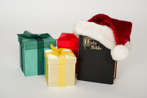 packages and a Bible as a gift