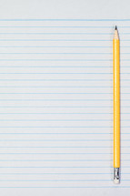 sharpened pencil on notebook paper
