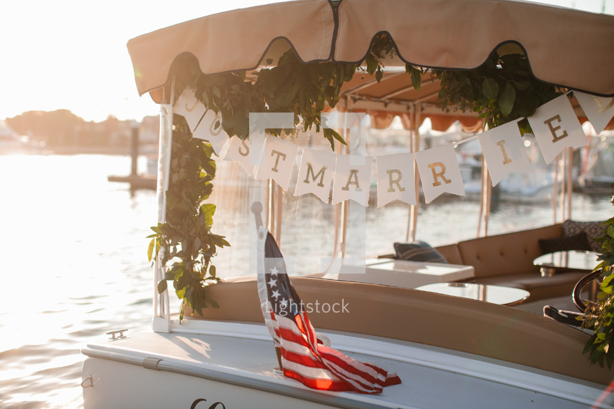 just married on the back of a boat