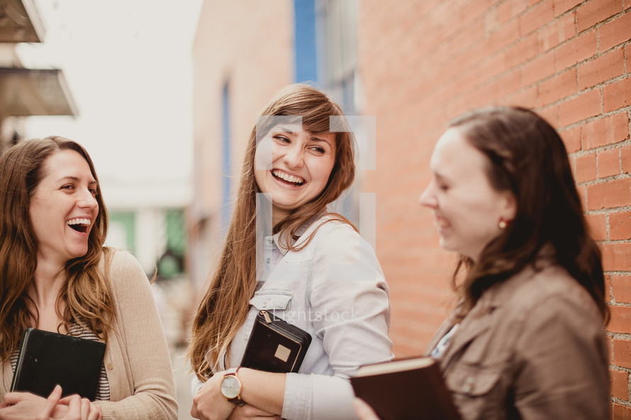 young women in a women's group holding Bibles