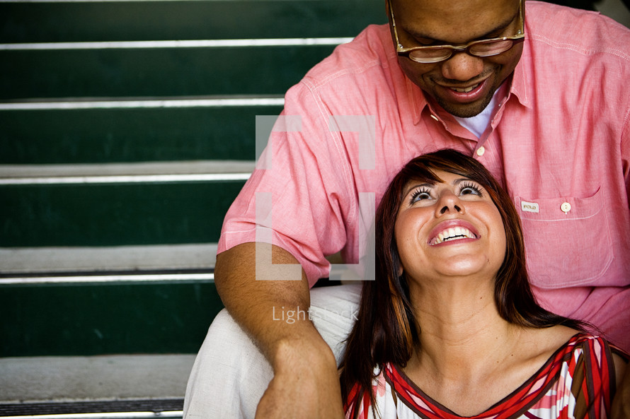 man in glasses looking down at a woman