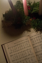 hymnal and Advent wreath