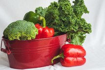 red and green vegetables in a bucket