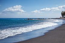 tide washing onto Santorini Beach