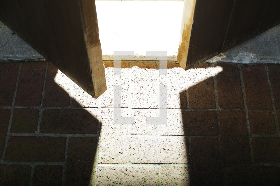 glow of sunlight pouring through a cracked doorway