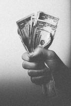Hand grasping paper money.