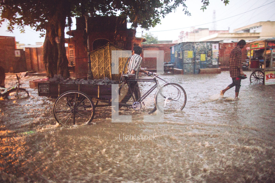People walking through the flooded streets of India.