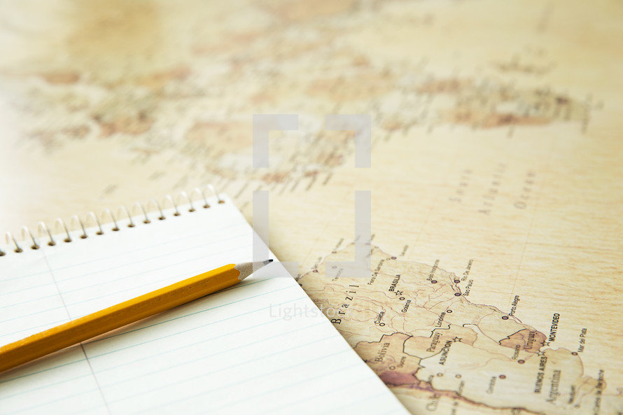 notebook, pencil, and map.
