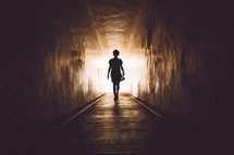 woman walking into the light