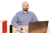 man sitting at his desk in an office