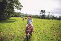 riding horseback
