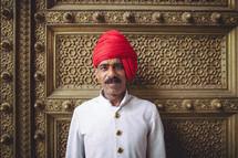 man in front of a gold door