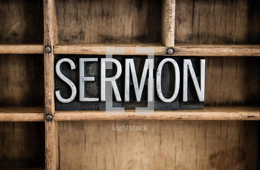 word sermon in blocks on a bookshelf