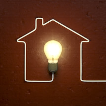 house shape with lightbulb