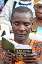 African man reading Bible