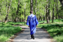 graduate walking on path