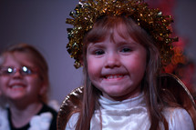 A little girl in an angel costume.