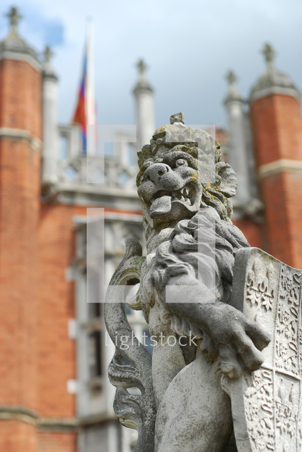 Lion holding a shield statue.