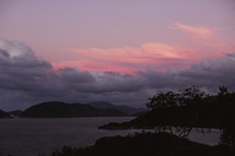 pink sky at sunset over islands