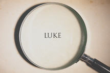 magnifying glass over Luke