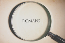 magnifying glass over Romans