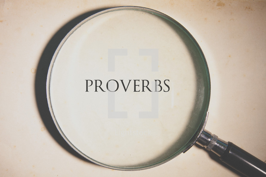 magnifying glass over Proverbs