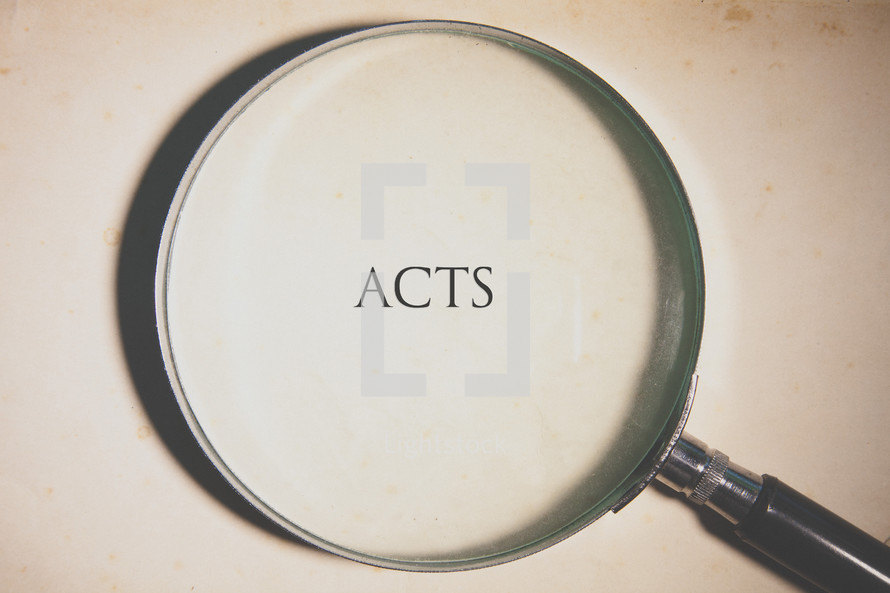 magnifying glass over Acts