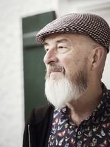 an elderly man in a hat