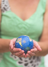 woman holding a small globe