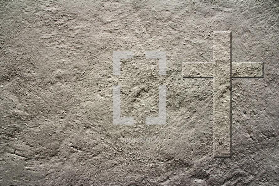 cross imprint on a concrete wall