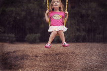 a girl child on a swing