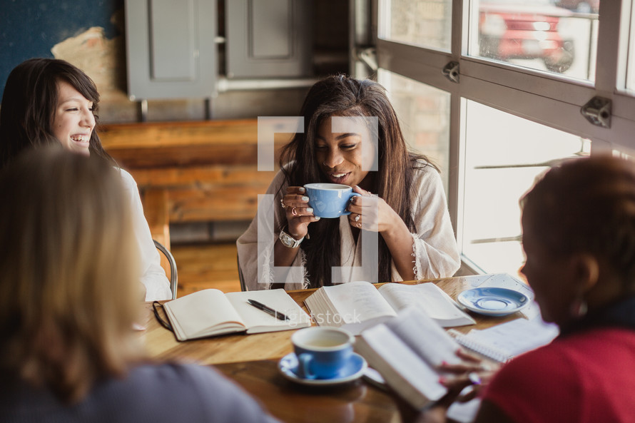 women reading Bibles and drinking coffee at a Bible study
