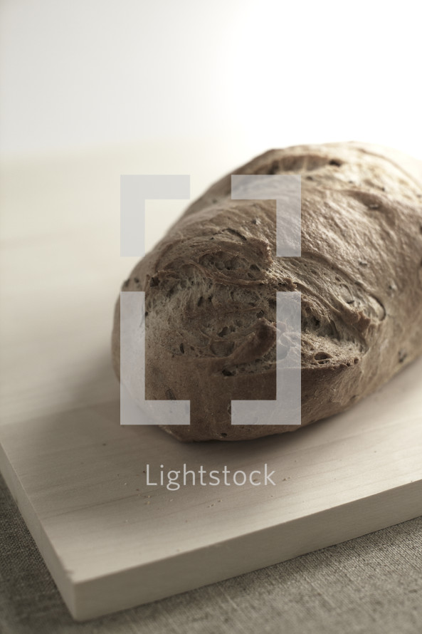 A loaf of bread on a cutting board