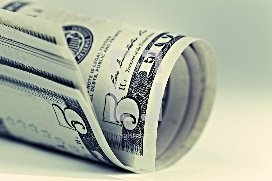 A roll of five dollar bills