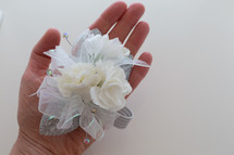 hand holding a corsage