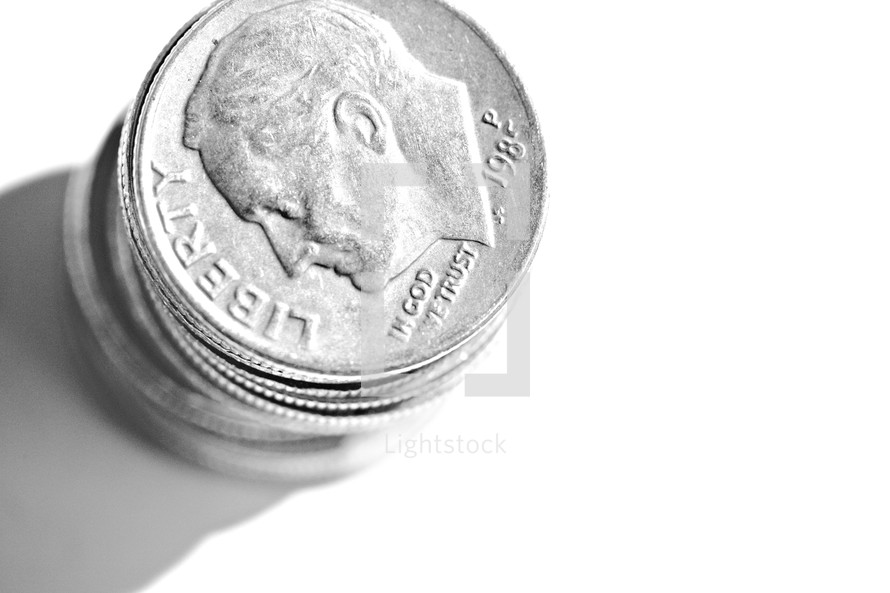 Stack of dimes isolated on white