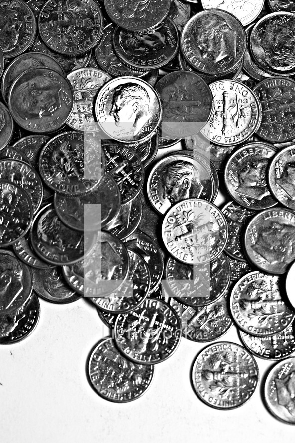 A pile of dimes isolated on white